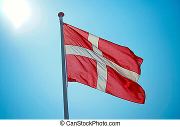 Danish flag with blue sky in the background