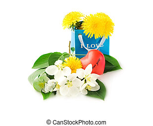 Paper bag with flowers and heart isolated on the white...