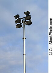 Little stadium lights tower in a blue sky background
