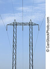 Power line tower on a blue sky background