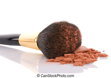 Make-up brush and brown powder