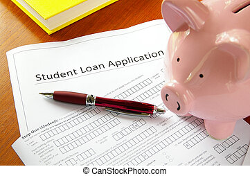 student loan application and piggy bank
