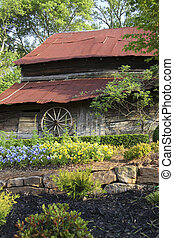 Old Barn and Wagon Wheel - Country barn with red tin roof...