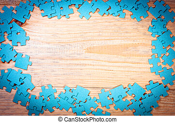 Wood background with puzzles.