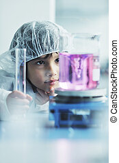 little child scientist in lab - cute little male child have...