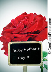 happy mothers day written in a blackboard label and a red...