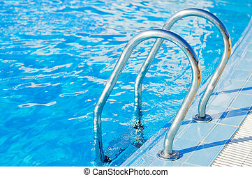 Ladder in pool with a handrail