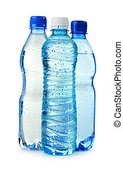 Three polycarbonate plastic bottles of mineral water isolated on white