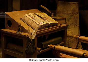 Table with the ancient book. vintage - Old table with the...