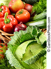 Vegetables in wicker basket - Composition with raw...