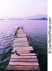 wooden pier with fringing purple zen aesthetic