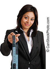 Business woman holding a measuring tape