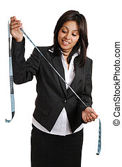 Business woman looking at a measuri
