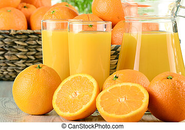 Glasses of orange juice and fruits