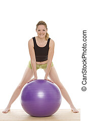 health - a woman with gymnastics ball