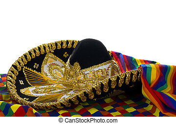 Mexcian Hat - Mexican ornate hat trimmed in gold resting on...