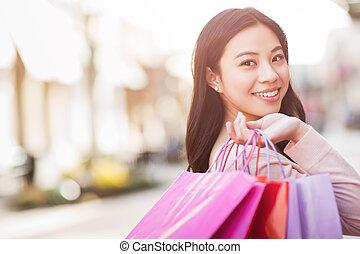 Asian woman shopping - A shot of an asian woman shopping...