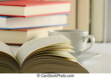 Books on the table - Composition with books and cup of...