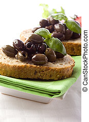 Bruschetta with olives - photo of delicious sliced bread...