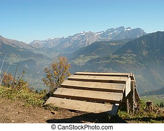 ramp leading off over the side of a mountain in switzerland