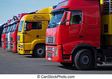 yellow and red semi trucks