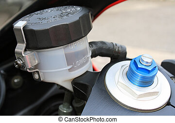 Motorcycle brake oil level and preload screw - The brake oil...