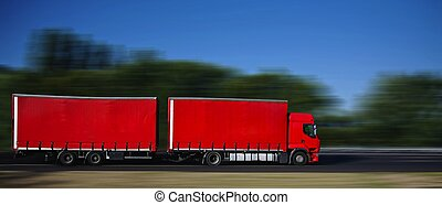red semi truck with trailer on highway
