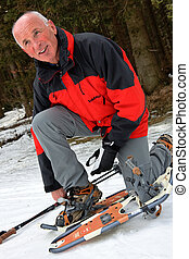 Senior at the snow-shoeing in the winter