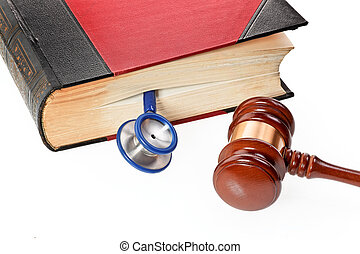 Stethoscope and Gavel - A blue stethoscope is a medical book