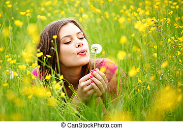 summer woman blow on dandelion