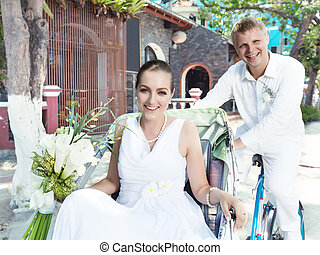 Bride and groom - Groom and bride driving cyclo on the...