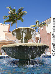Tiered Fountain - Water cascading over the edges of a tiered...