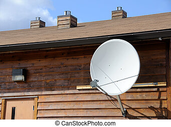 Satellite TV Dish Mounted on Cabin