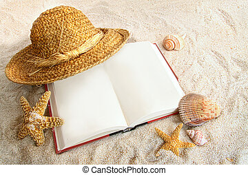 Book with straw hat and seashells in sand - Book with straw...