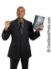 Man holding a bible preaching the gospel - This is an image...