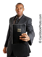 Man holding a bible showing commitment - This is an image of...