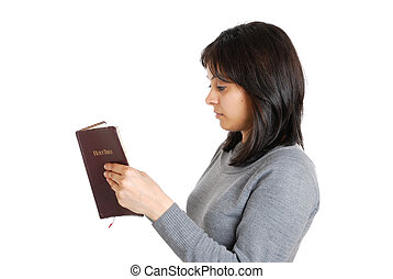 Young business woman studying a bible