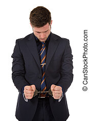 Young caucasian businessman, handcuffs - Young caucasian...