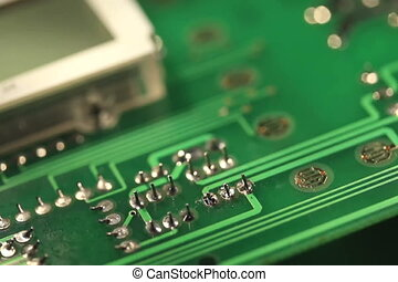 Technician repairing electronic circuit board with soldering...