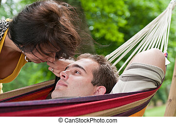 Intimate moments - young couple outdoors - Young couple in...