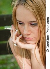 Problems - teenager smoking cigarette