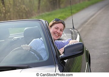 Woman driving a cabrio - Young woman driving a sports...