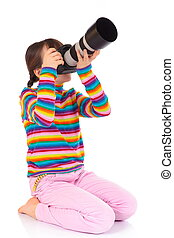 Girl taking photograph - Side view of girl in colorful...