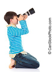 Boy with camera - A young boy taking a picture with a...