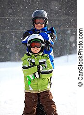 Kid skiers - Closeup of smiling young brothers in ski...