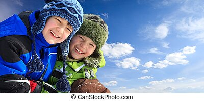 Children in ski clothing - Closeup of smiling young brothers...