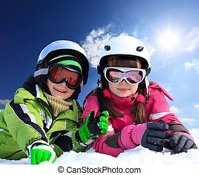 Children in ski clothing - Portrait of young boy and girl in...