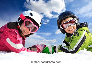 Children in ski clothing - Closeup of smiling young brother...
