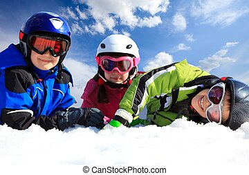 Children in ski clothing - Closeup of three young children...