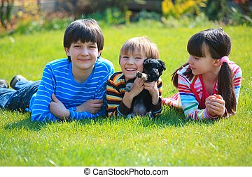 Children playing with dog